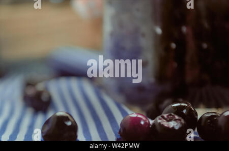 grapes Pickled health food in bottles - Stock Image