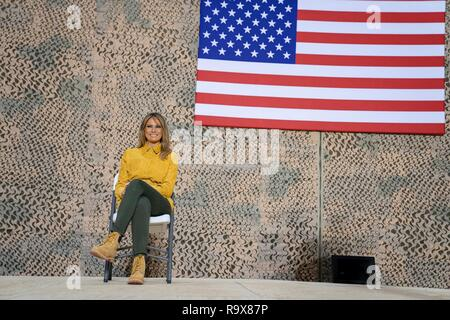 U.S. First Lady Melania Trump sits onstage as President Donald Trump addresses service members during a surprise visit to Al Asad Air Base December 26, 2018 in Al Anbar, Iraq. The president and the first lady spent about three hours on Boxing Day at Al Asad, located in western Iraq, their first trip to visit troops overseas since taking office. - Stock Image