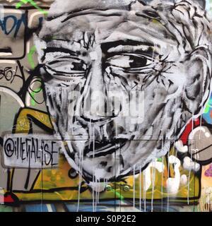 Street art of man in Melbourne laneway - Stock Image