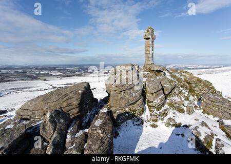 A fall of snow Widgery cross on Brat tor Dartmoor Devon Uk - Stock Image