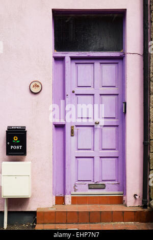 A brightly painted front door at Kinsale, Ireland. - Stock Image