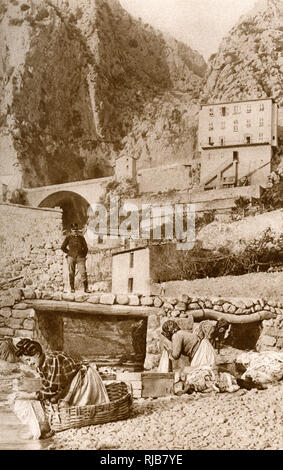 Washerwomen near a viaduct at the border between Italy and France. - Stock Image