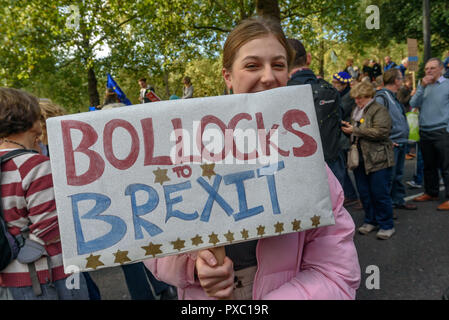 London, UK. 20th October 2018. A woman holds a banner 'Bollocks to Brexit. People gather with placards, banners and flags at Hyde Park Corner for the People's Vote March calling for a vote to give the final say on the Brexit deal or failure to get a deal. They say the new evidence which has come out since the referendum makes it essential to get a new mandate from the people to leave the EU. Peter Marshall/Alamy Live News - Stock Image
