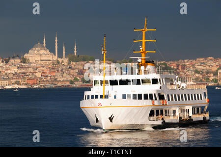 Passenger ship in the Bosphorus Strait. In the background is the Suleymaniye Mosque in the Vefa district of Istanbul, Turkey - Stock Image