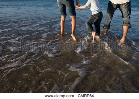 Family paddling in the sea - Stock Image
