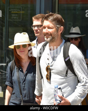 Karlovy Vary, Czech Republic. 27th June, 2019. American actress Julianne Moore, left, and her husband Bart Freundlich, right, arrive in Karlovy Vary Airport, Czech Republic, to the 54th Karlovy Vary International Film Festival, on June 27, 2019. The festival will be held from July 28 to July 6, 2019. Credit: Slavomir Kubes/CTK Photo/Alamy Live News - Stock Image
