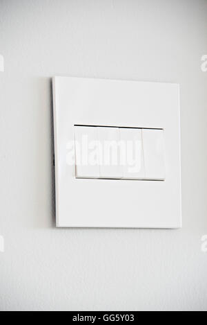 Close-up of light switches on wall - Stock Image