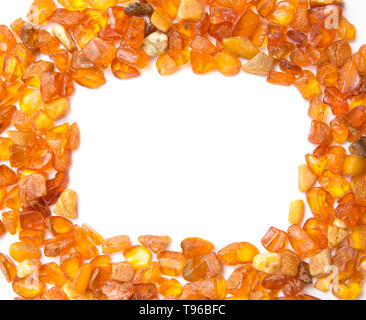 Frame made with chips of orange Baltic amber isolated on white. The Baltic region is home to the largest known deposit of amber, called Baltic amber o - Stock Image