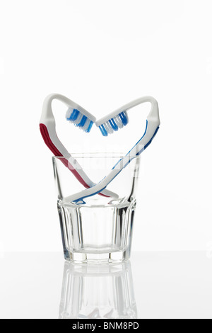 Toothbrushes Heart Shape in Glass - Stock Image