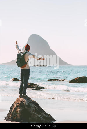 Man explorer enjoying sea view on empty beach traveling in Norway active vacations outdoor lifestyle adventure trip escape - Stock Image
