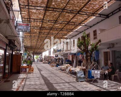 Turkey, Bodrum peninsula, Mugle province - bamboo sunshade roofing covers the main street of Yalikavak - Stock Image