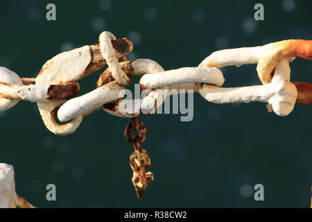 Closeup shot of a white chain with some rust on it - Stock Image