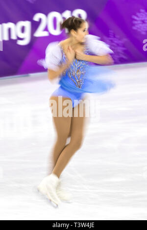 Blur motion action of Alexia Paganini (SUI) competing in the Figure Skating - Ladies' Short at the Olympic Winter Games PyeongChang 2018 - Stock Image