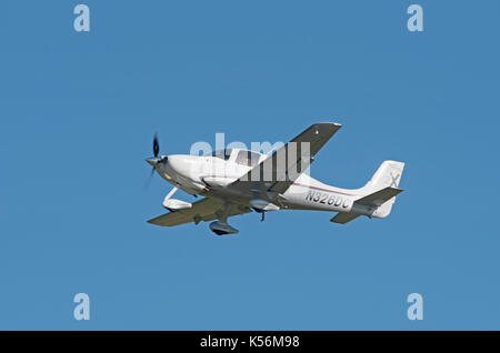 Cirrus R22 Single Engine 4 seat private aircraft leaving Inverness Airfield in the Scottish Highlands UK. - Stock Image
