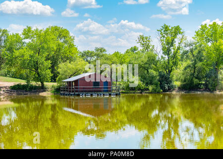 A rustic covered fishing dock at Sedgwick County Park in Wichita, Kansas, USA. - Stock Image