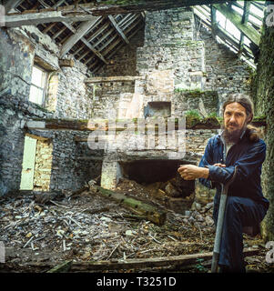 Period farmhouse ruin in the process of restoration by the owner in the Brecon Beacons, Wales in 1988. Shot on medium format  film - Stock Image
