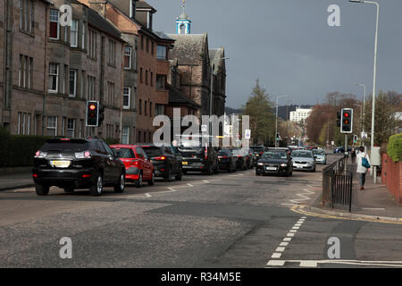 Traffic stopped at a pedestrian crossing in a suburb of Edinburgh - Stock Image
