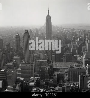1950s. New York, USA, aerial view over Manhattan and New York city showing skyscrapers and other buildings. - Stock Image
