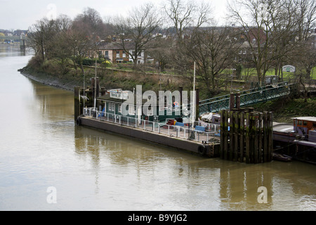 View of the South Bank of the River Thames and Kew Gardens Pier from Kew Bridge, Looking East, Kew, Richmond, Surrey, - Stock Image