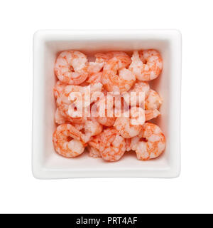 Pile of small cooked shrimps in a square bowl isolated on white background - Stock Image
