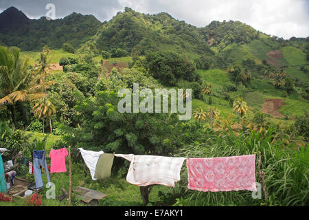 Green-Crested hills, Central St Vincent, woman washing and clothes drying - Stock Image