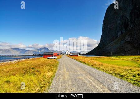 Gravel road to the village Eggum on Lofoten in Norway. - Stock Image