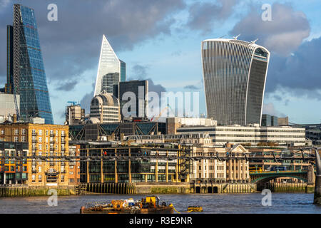 LONDON - NOVEMBER 15 : Modern skyscrapers in riverfront skyline of London, England against blue skies on sunny day on 15 November 2018 - Stock Image