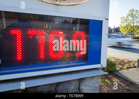 A gas station sign displays the new North American all time high gas price in Vancouver, Canada. - Stock Image