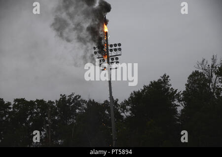 Waldorf, Maryland USA October5,2018  A high school soccer game was postponed after stadium lights that were lighting up the field at Weslake High School burst out in heavy smoke and fire during the game explosions from the lightpole sent both teams running off the field and canceling the game - Stock Image