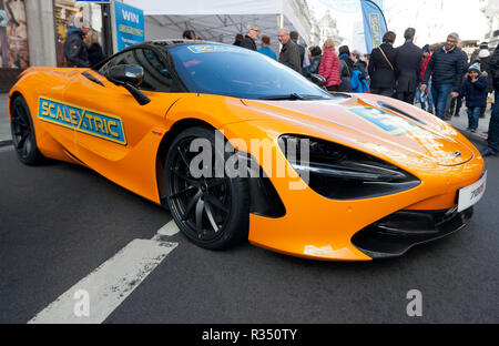 Three-quarters front view of a yellow McLaren 720S, at the Scalextric stand, at the 2018 Regents Street Motor Show. - Stock Image