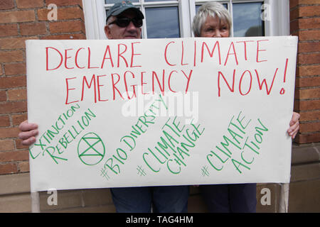 Activists from the Climate Change group Extinction Rebellion hold a banner saying ÒDeclare Climate Emergency NowÓ  during a demo outside Derby City Council house on 22/05/2019 - Stock Image