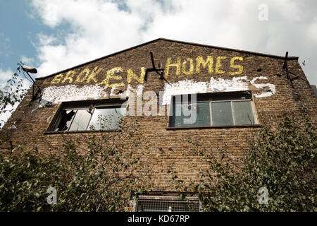 Derelict building with protest graffiti in East London, UK - Stock Image