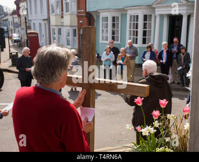 Thaxted Essex England UK. Traditional Easter Good Friday Procession of Witness through Thaxted. 19 April 2019Daniel Fox carries the Holy Cross from the Roman Catholic Church, via the Baptist Church, past the Anglican Church and on to a service in the United Reform Church during the traditional Procession of Witness through the beautiful small town of Thaxted in north west Essex, England. Credit: BRIAN HARRIS/Alamy Live News - Stock Image