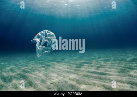 A single plastic bag floats over a sea bed in Abu Dabbab, Egypt - Stock Image