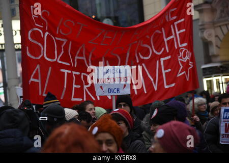 Vienna, Austria. 13th Jan, 2018. anti-government protesters hold a red banner demanding a socialist alternative - Stock Image