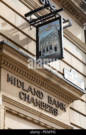 The pub sign of the North and South Wales Bank Wetherspoon public house Wrexham Wales June 2017 - Stock Image