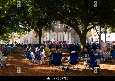 Outdoor Concert in the Park Naples Florida fl december winter vacation crowd chairs bandshell - Stock Image