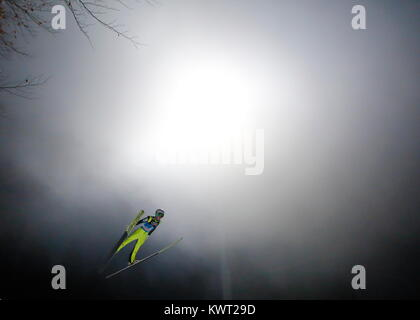 Bischofshofen, Austria. 05th, Jan 2018. Rupitsch Markus from Austria soars through the air during the qualification - Stock Image