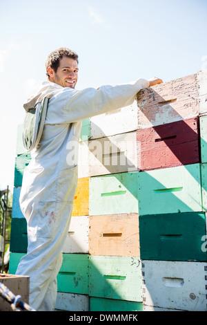 Beekeeper Loading Stacked Honeycomb Crates - Stock Image