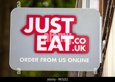 COVENTRY, UK - JULY 26TH 2018: A Just Eat sign outside a takeaway restaurant in the city of Coventry, UK, on 26th July 2018. - Stock Image