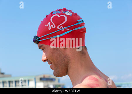 Bournemouth, Dorset UK. 14th July 2019. Pier to Pier swim where swimmers brave the English Channel swimming from Bournemouth to Boscombe piers in 1.4 mile open water challenge, raising funds for BHF, British Heart Foundation. Credit: Carolyn Jenkins/Alamy Live News - Stock Image