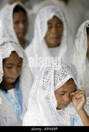 A Filipina weeps during a reenactment of Christ's passion at a Catholic Church in Mansalay, Oriental Mindoro, - Stock Image