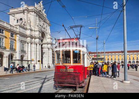 28 February 2018: Lisbon, Portugal - A queue of people getting onto a red tram in Praca de Comercio, or Terreiro de Paco, on a bright sunny day, the l - Stock Image
