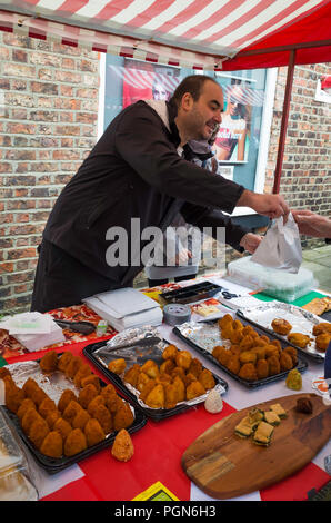A woman buying food at an Armenian  fast food stall in a Christmas food market in Middlesbrough Cleveland North Yorkshire England UK - Stock Image