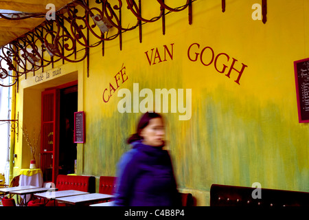 Arles; Bouches du Rhone, France; A young woman walking in front of the former Cafe Terrace - Stock Image