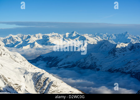 Panorama of swiss alps in winter, view from Mitelallalin, Saas Fee, Valais, Switzerland - Stock Image