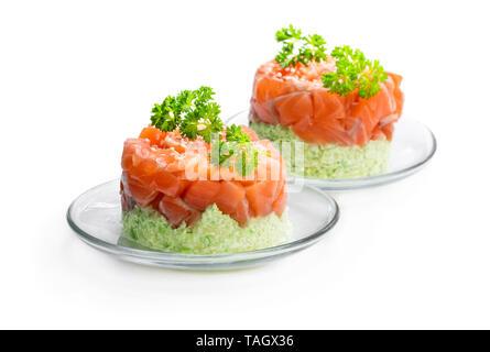 Salmon  tartare with avocado isolated on white - Stock Image