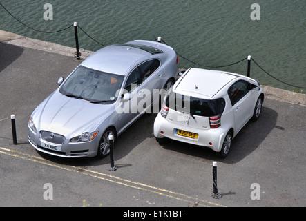 smart car parked on quayside, Brixham, Devon, England, UK - Stock Image