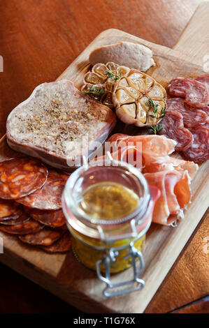 'Assorted meats with garlic and preserve in cocktail lounge of The Zetter Townhouse in London, England' - Stock Image