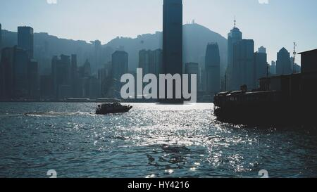City At Waterfront Against Clear Sky - Stock Image